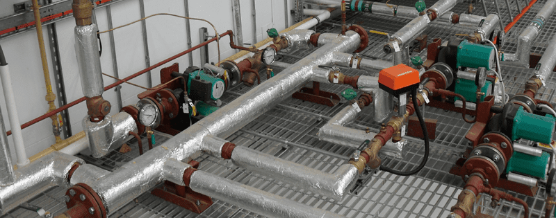 Insulated steam main pipework in factory