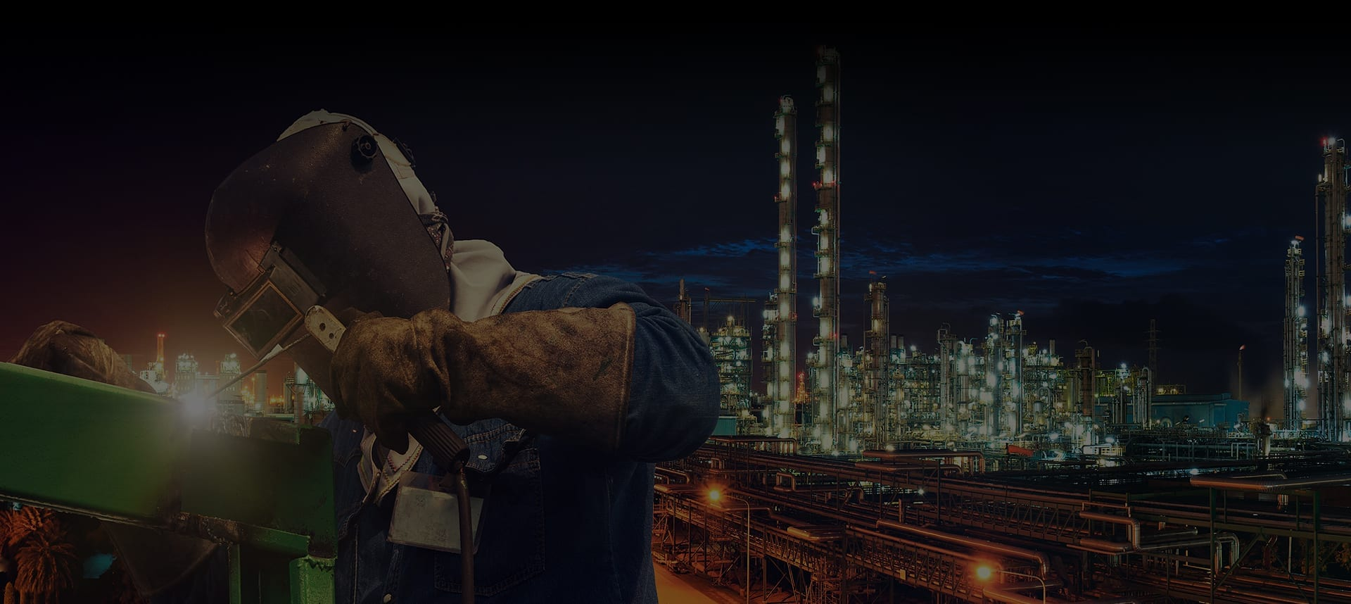 Pipework Welder with Industrial Plant in the Background